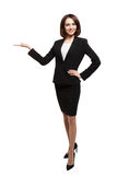 Happy smiling young business woman presenting Stock Photography