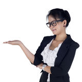 Happy smiling young business woman showing blank area for sign o Stock Photography