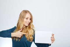 Happy smiling young business woman showing blank Stock Photos