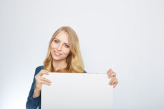 Happy smiling young business woman showing blank Royalty Free Stock Photo