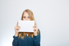 Happy smiling young business woman showing blank Stock Images