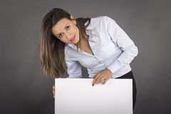 Happy smiling young business woman showing blank signboard Royalty Free Stock Photos