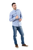 Happy smiling young businessman with thumbs up gesture looking at camera Stock Image