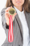Happy smiling Young Businesswoman holds up her gold medal Royalty Free Stock Images