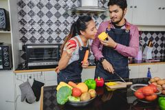 Happy and Smiling young couple cooking food in the kitchen at home stock photos