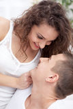 Happy smiling young couple at home fooling around stock photos