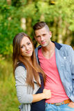 Happy smiling young couple outdoor Stock Images