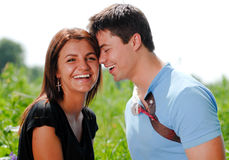 Happy smiling young couple outdoors Royalty Free Stock Images