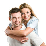 Happy smiling young couple piggyback Royalty Free Stock Images