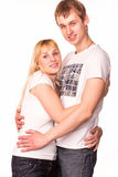Happy smiling young couple standing together hugging Stock Image