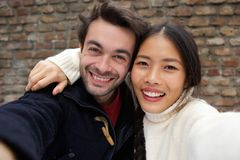 Happy smiling young couple taking selfie Royalty Free Stock Photography
