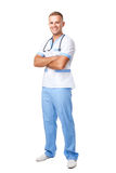 Happy smiling young doctor in uniform Stock Photography
