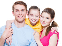 Happy smiling young family with little girl. Royalty Free Stock Image