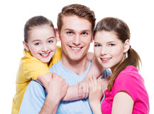 Happy smiling young family with little girl. Stock Images