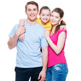 Happy smiling young family with little girl. Royalty Free Stock Photo