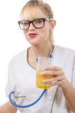 Happy smiling young female doctor with orange juice Stock Image