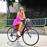 Happy smiling young girl on a bicycle in summer Royalty Free Stock Photo