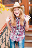 Happy smiling young girl in cowboys hat. In autumn outdoors royalty free stock photo