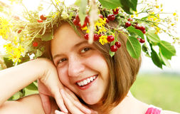 Happy smiling young girl with flower crown Royalty Free Stock Image