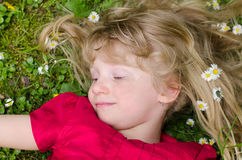 Happy smiling young girl in grass royalty free stock photo