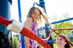 Happy smiling young girl in playground Royalty Free Stock Photos