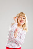 Happy smiling young girl with raised hands Stock Image