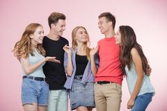 Happy smiling young group of friends standing together talking and laughing. Best friends royalty free stock images
