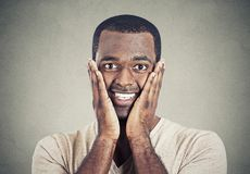 Happy smiling young handsome man looking shocked surprised Royalty Free Stock Photo