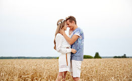 Happy smiling young hippie couple outdoors Stock Image
