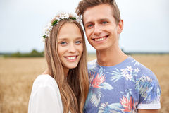 Happy smiling young hippie couple outdoors Royalty Free Stock Image