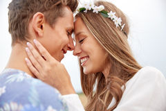 Happy smiling young hippie couple outdoors Stock Images