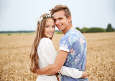 Happy smiling young hippie couple outdoors Stock Photography