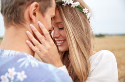 Happy smiling young hippie couple outdoors Royalty Free Stock Photos