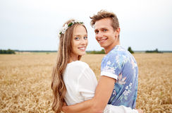 Happy smiling young hippie couple outdoors Stock Photo