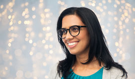 Happy smiling young indian woman in glasses Royalty Free Stock Images