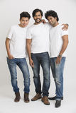 Happy smiling young male friends standing Stock Images