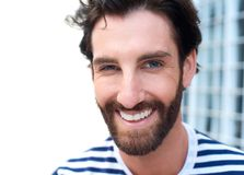 Happy smiling young man with beard Royalty Free Stock Photo