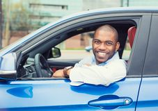 Happy smiling young man buyer sitting in his new car. Closeup portrait happy smiling young man buyer sitting in his new car excited ready for trip isolated royalty free stock photos