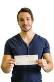 Happy, smiling young man with check Stock Image