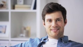 Happy smiling young man at home stock footage