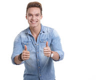 Happy smiling young man looking at camera with satisfaction isol Stock Photography