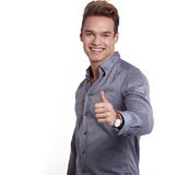 Happy smiling young man looking at camera with satisfaction isol Stock Photo