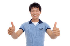 Happy smiling young man show thumb Stock Images