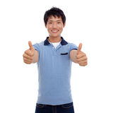 Happy smiling young man show thumb Stock Photo