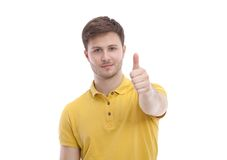 Happy smiling young man showing ok, isolated on Royalty Free Stock Photos