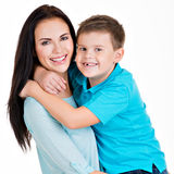 Happy smiling young mother with son Royalty Free Stock Images