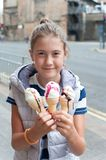 Happy smiling young pretty girl with many ice-cream. Outdoors image. stock images