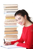 Happy smiling young student woman with books Stock Photos