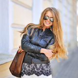 Happy smiling young woman with bag in sunglasses Royalty Free Stock Photography