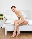 Happy smiling young woman with beautiful legs Stock Image